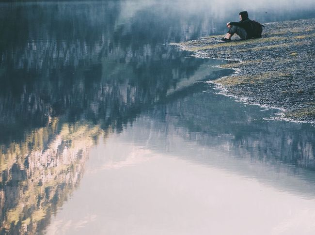 Water Leisure Activity Real People Lifestyles Reflection Nature Men Outdoors Day Scenics Tranquility Lake One Person Sky Switzerland Mountains Lake View Reflection Alps Live For The Story Breathing Space Lost In The Landscape