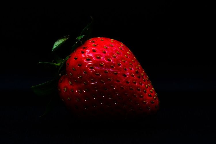 Close-up of strawberry against black background