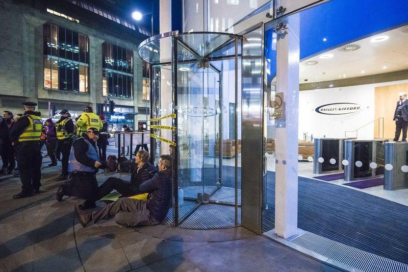 People on street seen through glass window at night