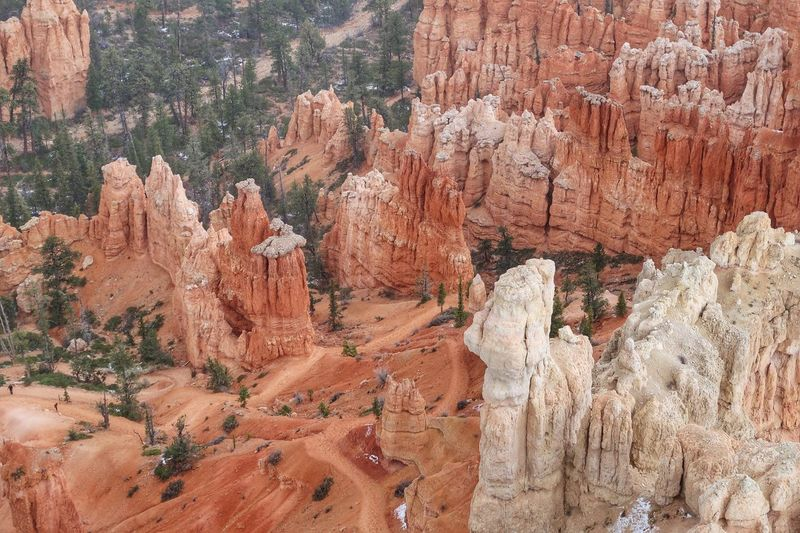 High angle landscape of orange and white spires and hoodoos in bryce canyon national park