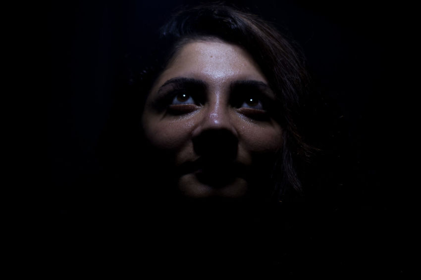 Adult Black Background Body Part Close-up Contemplation Copy Space Dark Fear Front View Headshot Human Body Part Human Face Human Lips Indoors  Looking At Camera One Person Portrait Studio Shot Women Young Adult The Portraitist - 2018 EyeEm Awards