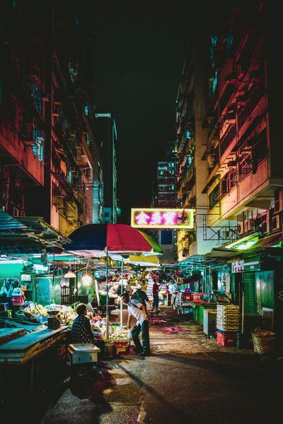night market Discoverhongkong Reframinghk Nightshooters Street Photography Night Illuminated Building Exterior Architecture City Built Structure Street Transportation Outdoors Building City Life Group Of People Incidental People Real People Lifestyles Nature Mode Of Transportation Travel Destinations Men Motor Vehicle