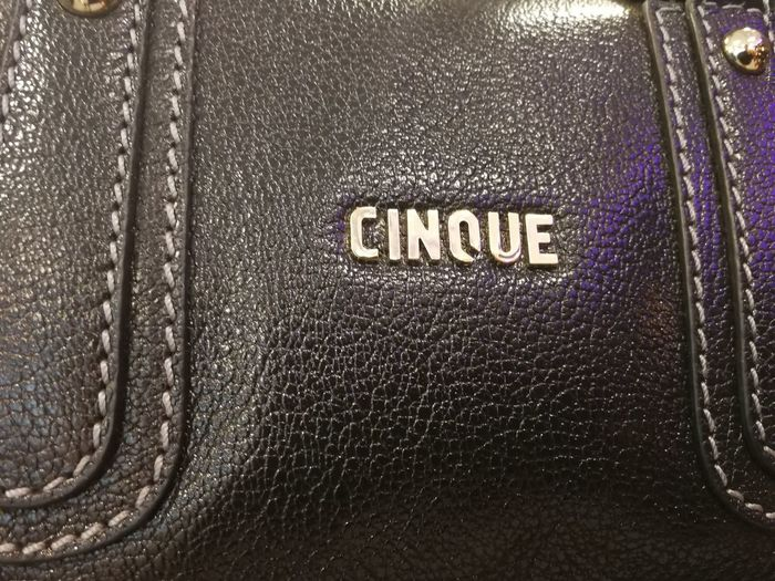 Cinque emblem. This German company provides casual fashion for men and women Boutique Cinque Fashion Shopping Shopping Center Shopping ♡ Brand Close-up Fashion Influencer Leather Luxury No People Retail  Shop Shopaholic Shopping Centre Shopping Mall Shopping Time Store Text Textile Western Script