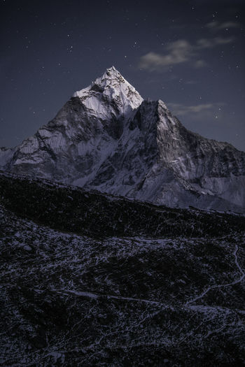Ama Dablam is a mountain in the Everest region in Nepal. This mountain stands out the most, even more than the Everest itself, for its unique shape and its very cool name. Mountain Sky Night Mountain Range Snow Mountain Peak Tranquil Scene Landscape Epic Gigantic The Himalayas Himalaya Ama Dablam Snowcapped Mountain Cold Temperature Tranquility Winter Nepal Everest Region Dusk The Great Outdoors - 2019 EyeEm Awards The Great Outdoors - 2019 EyeEm Awards