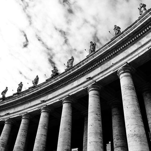 Italy, Rome, Low Angle View Of Colonnade With Sculptures