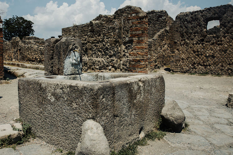 Pompeii  Pompeii Ruins Italy History Art And Craft Day Architecture Sculpture Sky Nature The Past Statue Solid Water Human Representation No People Representation Built Structure Rock Creativity Rock - Object Outdoors Stone Wall