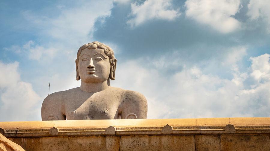 Gomatesawara statue with bright blue sky at morning