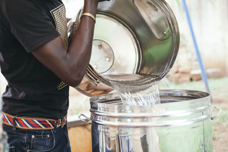 Man pouring water into tank