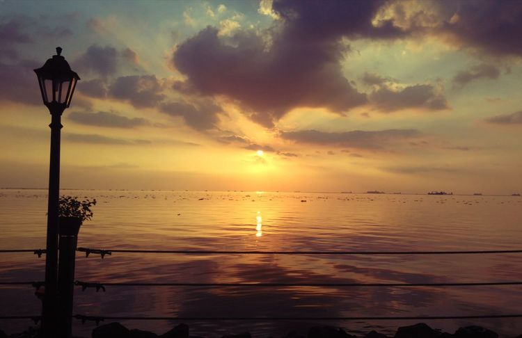 Sunset Sea Sun Cloud - Sky Tranquility Silhouette Horizon Over Water Scenics Sky Reflection Tourism Outdoors Beauty In Nature Tranquil Scene Ethereal Beauty Beauty In Nature