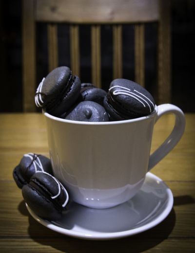 Macarons Close-up Coffee Coffee - Drink Coffee Cup Crockery Cup Drink Focus On Foreground Food Food And Drink Freshness Indoors  Mug No People Non-alcoholic Beverage Refreshment Saucer Spoon Starbucks Still Life Table Wood - Material