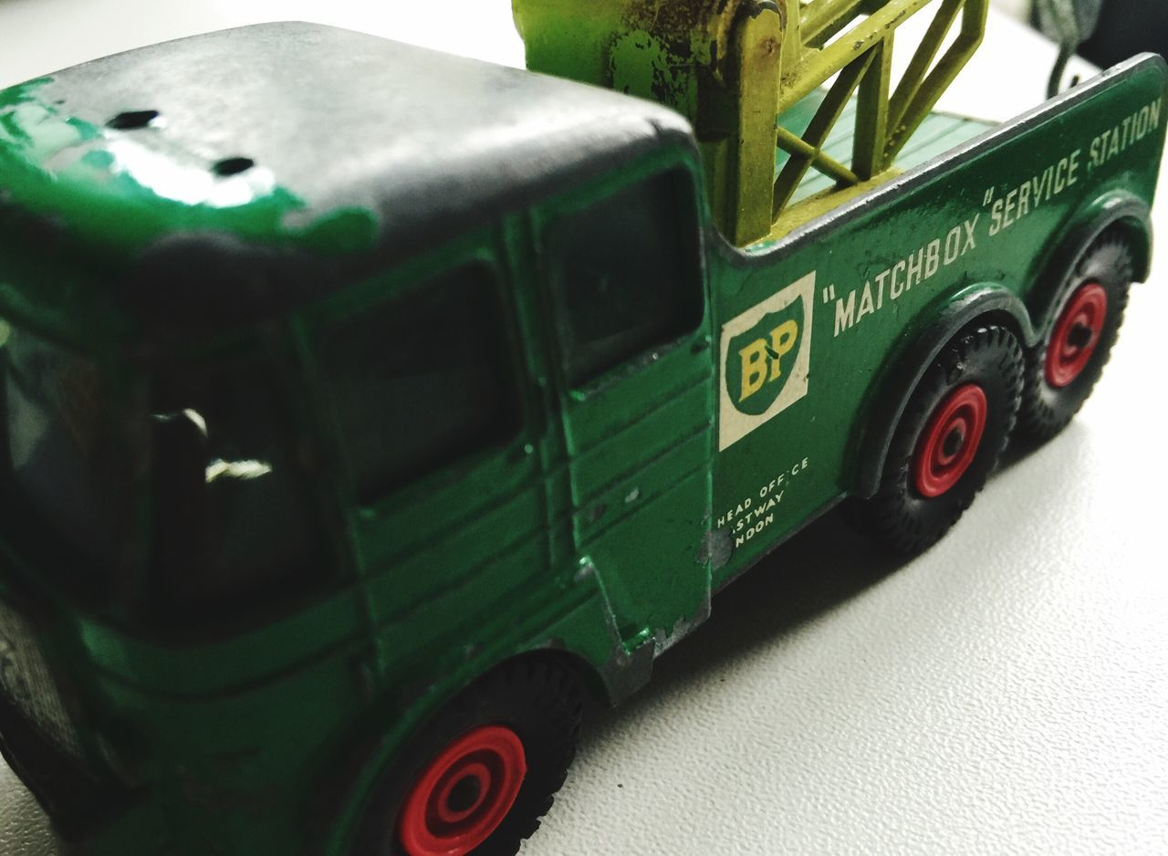 green color, no people, land vehicle, day, indoors, technology, close-up