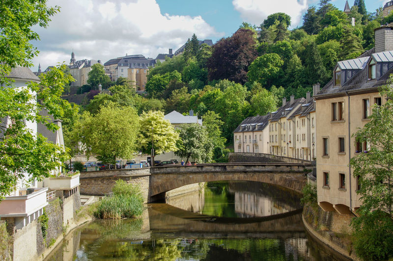 Grund Neighborhood of Luxembourg Architecture Built Structure Water Building Exterior Reflection Nature Bridge Building Sky River Bridge - Man Made Structure Connection No People City Day Transportation Outdoors Arch Bridge River Reflection