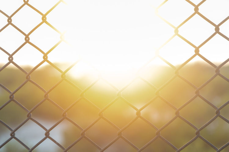 Close-up of chainlink fence against clear sky