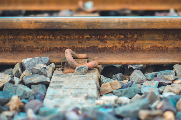 Close-up of stones on railroad track