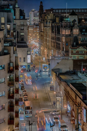Architecture_collection Cityscape Great Britain Manchester Night Lights United Kingdom Architecture Bus City City Life England Europe High Angle View Illuminated Light Trail Mode Of Transportation Outdoors Street Street Photography Transportation Urban Urban Skyline