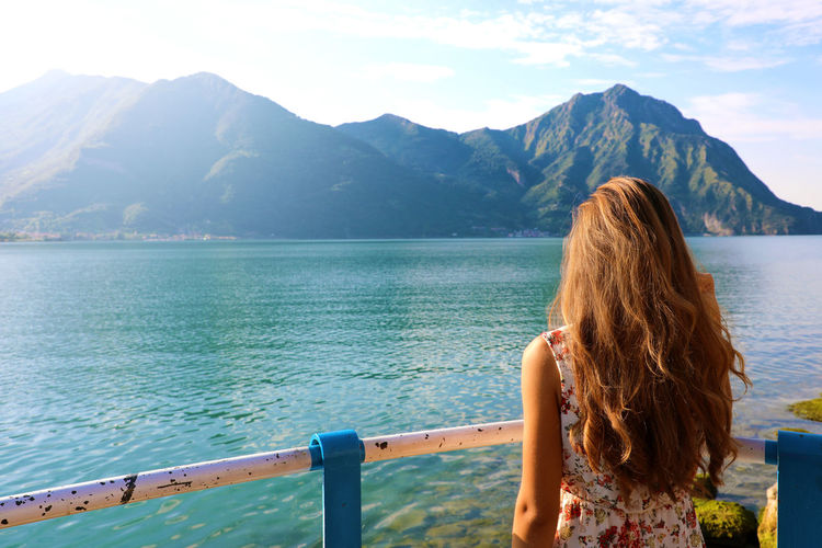 Woman in Lovere on Lake Iseo, Italy Lakeview Woman Beauty In Nature Hair Hairstyle Lake Lake View Lakeshore Lakeside Leisure Leisure Activity Lifestyles Long Hair Lovere Lovere Lake Mountain Mountain Range Nature One Person Outdoors Real People Relax Scenics - Nature Water Woman Portrait