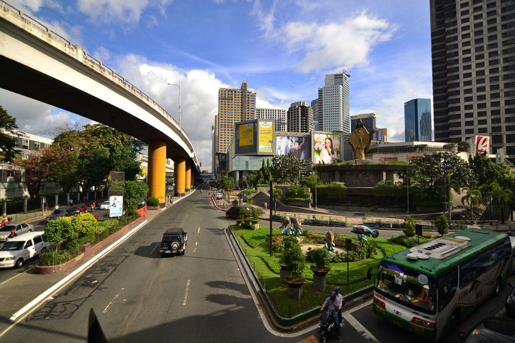 EDSA cor. Ortigas Ave. City Architecture Transportation Car Travel Building Exterior Skyscraper Built Structure Modern Sky Tree Bridge - Man Made Structure Travel Destinations Urban Skyline Outdoors Day No People Cityscape Nikon D3100 Tokina 11-16 F/2.8 Eyeem Philippines Ortigas Pasig City Metro Manila Philippines