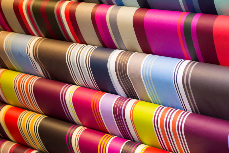 Close-up of colorful fabrics for sale in store