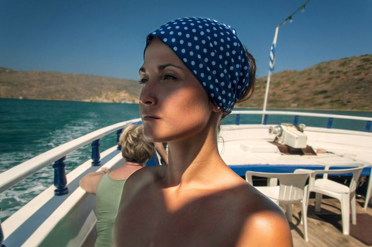 EyeEm Selects Water Sea Vacations Adult Only Women Adults Only One Woman Only Summer One Person Outdoors Leisure Activity Day Nautical Vessel Women People Sky Travel Destinations Young Adult Nature Human Body Part Aegean Sea Woman Greece Crete