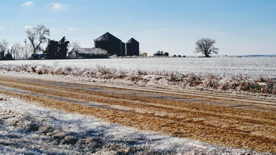 """Visual Journal January 17, 2017 Western, Nebraska - 15 and 16 January 2017 Ice Storm - Over the course of 15 and 16 January 2017, an upper-level storm system tracked from northwest Mexico into the central Plains. A seasonably moist low-level air mass present ahead of the upper-air disturbance surged north through the Great Plains, atop a sub-freezing, near-surface layer of air. The net result was a widespread ice storm which affected locations from the southern High Plains into the mid Missouri River Valley. This winter storm was unusual from the perspective that the predominant precipitation type was freezing rain with little in the way of observed snowfall. Over eastern Nebraska and southwest Iowa, ice accumulations ranged from 0.50-0.75"""" across southeast Nebraska to 0.10-0.20"""" in the Omaha Metro area. Camera Work Canon FD 50mm F/1.8 Country Road Extreme Weather Eye 4 Photography EyeEm Gallery Farm FUJIFILM X-T1 Ice Storm Icy Day Manual Focus My Neighborhood Nebraska Weather Photo Diary Photo Essay Photography Rural America Rural Scene Small Town Stories Storytelling Visual Journal Winter Winter Wonderland Winterscapes Winterwonderland The Great Outdoors - 2017 EyeEm Awards"""