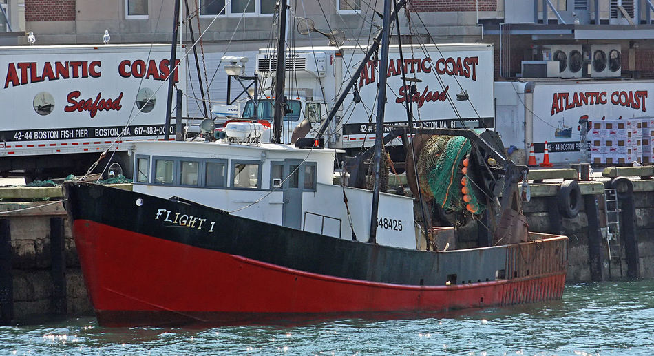 A Taste Of Boston, Mass Atlantic Coast Fisheries Canning Fishing Company Communication Day Harbor Nautical Vessel No People Outdoors Riot Sea Text Transportation Trawler Water Seafood Company