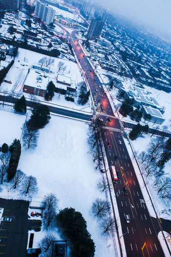 High angle view of street amidst buildings during winter