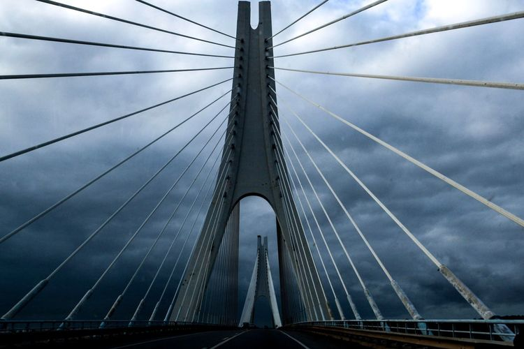 Spiderweb Bridge Bridge - Man Made Structure Built Structure Sky Connection Architecture Transportation Cloud - Sky Engineering Suspension Bridge Cable Steel Cable Low Angle View Nature Metal Cable-stayed Bridge Travel Destinations Travel The Way Forward Outdoors