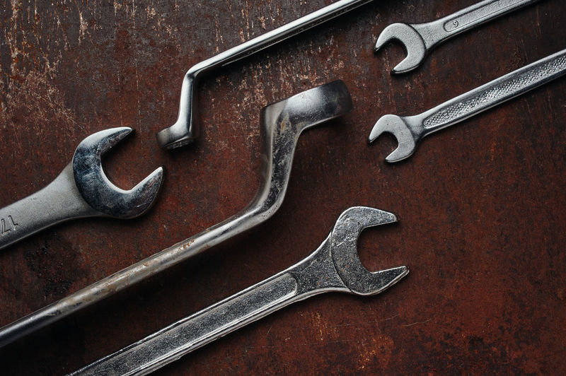 Close-up of work tool over rusty metal