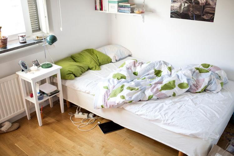 View of empty bed in bedroom