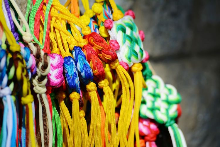 Close-up of multi colored band for sale