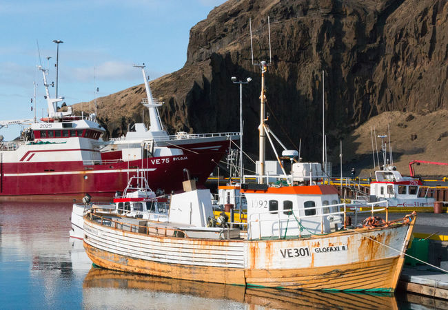Heimaey Iceland Architecture Day Fishing Boat Fishing Industry Harbor Mode Of Transportation Moored Mountain Nature Nautical Vessel No People Outdoors Pier Port Sailboat Sea Ship Sky Transportation Water Waterfront