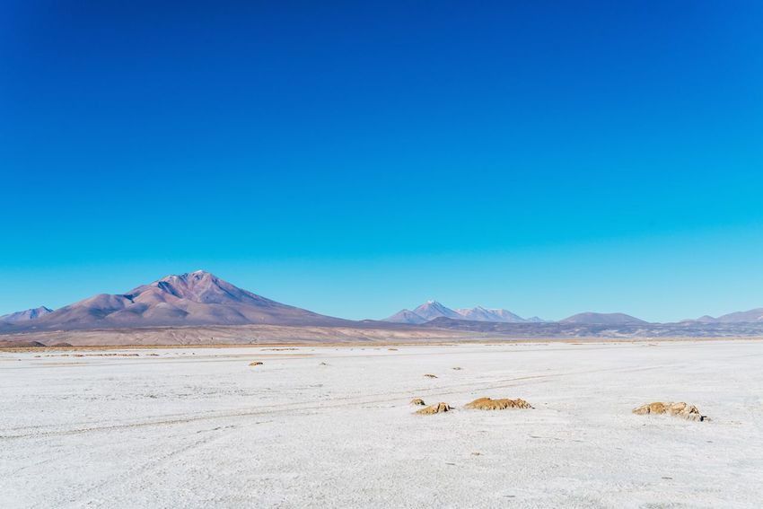 Lost In The Landscape Arid Climate Beauty In Nature Blue Clear Sky Day Desert Landscape Mountain Mountain Range Nature No People Outdoors Physical Geography Salt - Mineral Salt Flat Sand Scenics Sky Tranquil Scene Tranquility