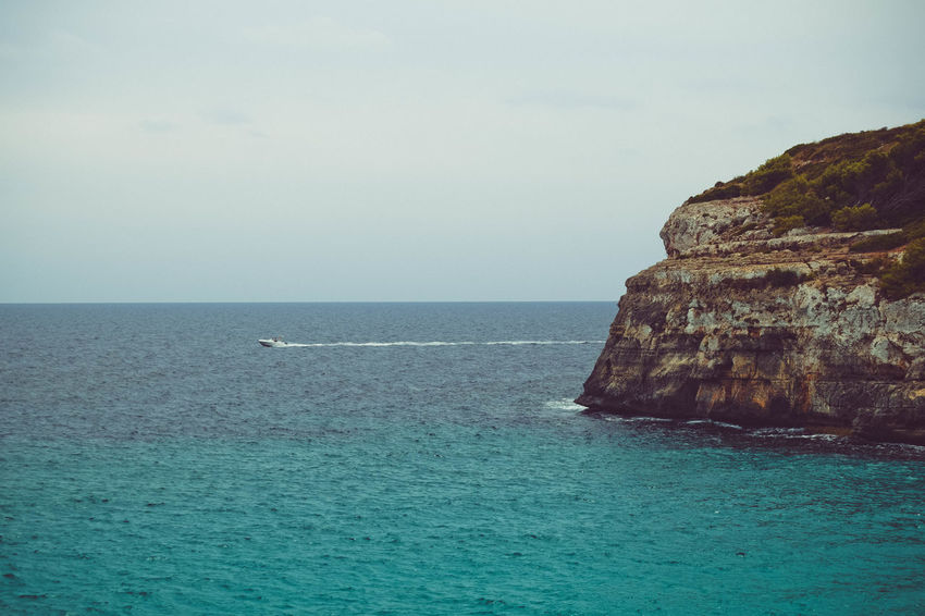 Beauty In Nature Boat Cliff Day Horizon Horizon Over Water Idyllic Land Marine Nature No People Outdoors Rock Rock - Object Rock Formation Scenics - Nature Sea Sky Tranquil Scene Tranquility Turquoise Colored Water Waterfront