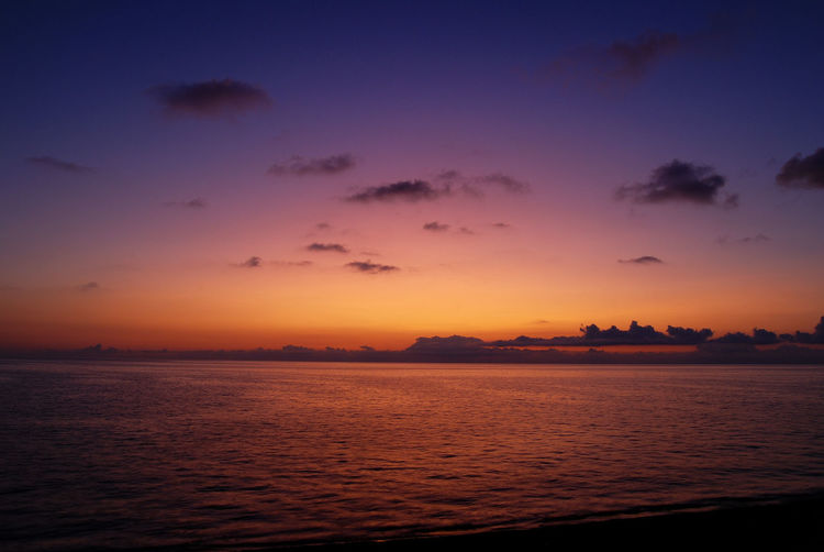 Scenic View Of Sea Against Romantic Sky During Sunset