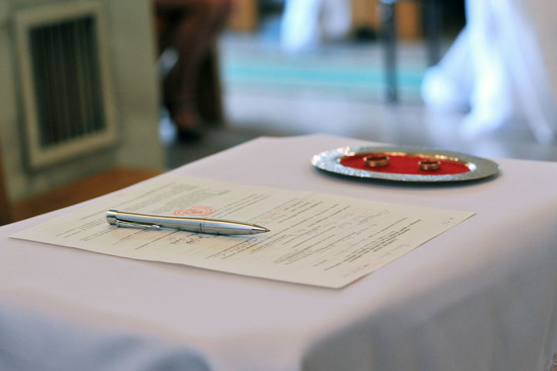 Close-up of pen and document on table during wedding