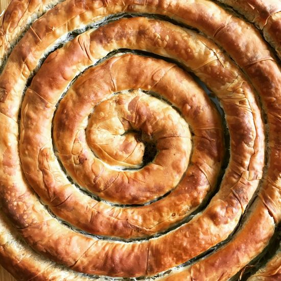 Spanikopita Wheel Lunch Spanikopita Wheel Backgrounds Close-up Day Food Food And Drink Freshness Fruit Full Frame Greek Food Healthy Eating Indoors  No People Pin Wheel Ready-to-eat Spinach Pie