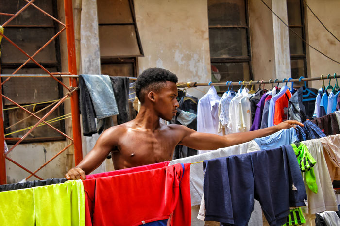 Drying. One Person Day Outdoors People One Man Only Clothes Clothesline Clothing Adults Only Retail  Adult Only Men Colors Color Portrait Color Palette Colorful Colour Of Life Color Photography Colourful Check This Out Eyeemphotography