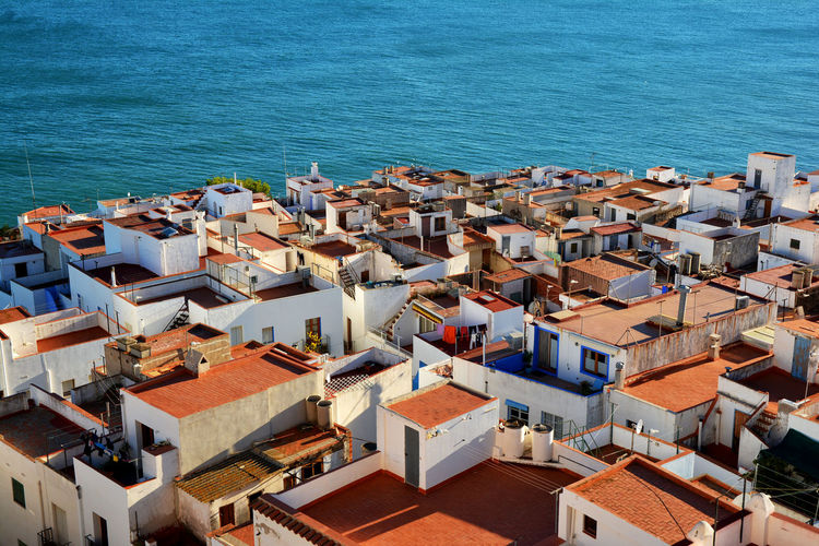 High angle view of houses by sea