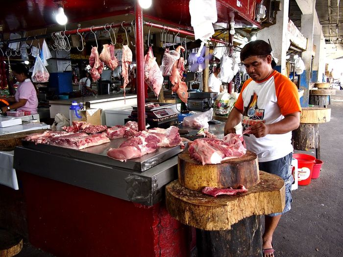 meat vendor at a market ASIA Philippines Asian  Filipino Man Males  Butcher Meat! Meat! Meat! Pork Beef Food Raw Fresh Raw Food Sale Business Butcher Market Stall Stall Market Market Vendor Vendor Farmer Market