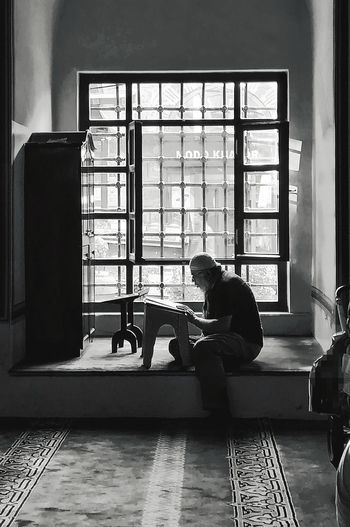 Reading Window Mosque Ulucami Adult Day Islam Islamic Indoors  Sitting One Person Blackandwhite Muslim People Lifestyles Travel Destinations Book Real People City EyeEm EyeEm Gallery EyeEm Best Shots EyeEm Ready   AI Now EyeEmNewHere This Is Masculinity Stories From The City