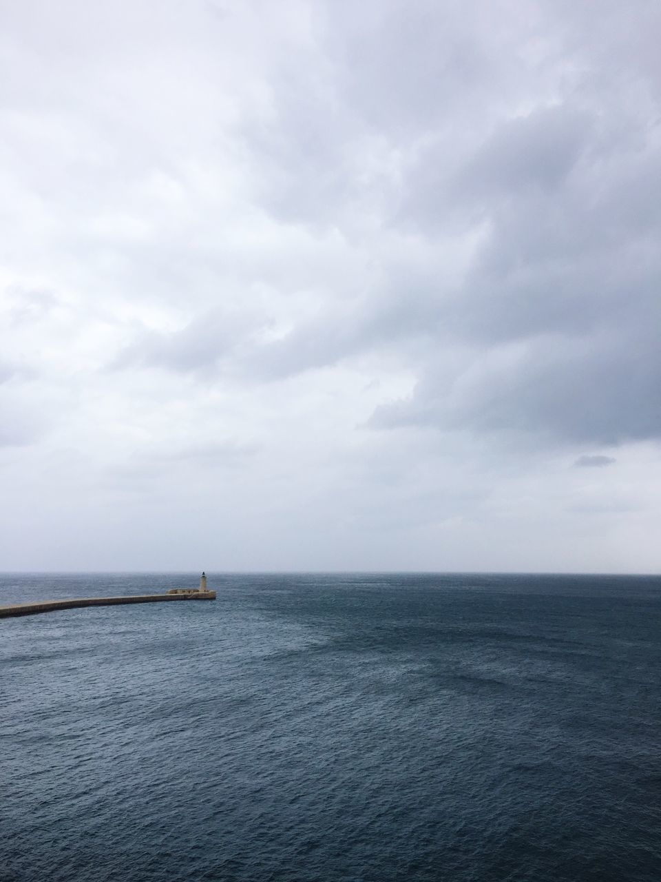 sea, waterfront, water, horizon over water, sky, tranquil scene, tranquility, scenics, beauty in nature, nature, rippled, cloud - sky, cloudy, seascape, cloud, idyllic, outdoors, day, no people, remote