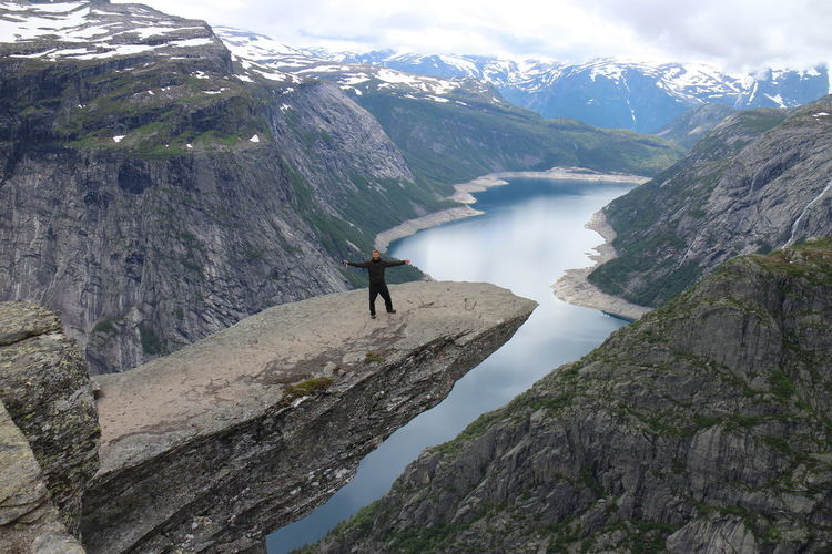 #norway #trolltunga Adventure Beauty In Nature Cloud - Sky Day Idyllic Landscape Leisure Activity Lifestyles Mountain Nature Non-urban Scene Rock - Object Rock Formation Rocky Mountains Scenics Sky Snowcapped Mountain Tourism Tourist Tranquil Scene Tranquility Unrecognizable Person Vacations