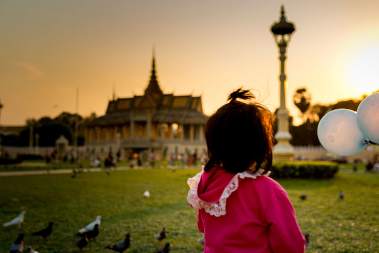 View of girl watching royal stupa