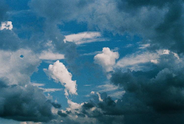 Cloudy skies EyeEmNewHere EyeEm EyeEm Best Shots EyeEm Gallery Day Outdoors Chilling Lifestyles Analog Film 35mm Film Bird Blue Backgrounds Sky Only Full Frame Flying Abstract Painted Image Sky Cloud - Sky Meteorology Cloudscape Cumulus Cloud Dramatic Sky Atmospheric Mood Stratosphere Storm Cloud Heaven Moody Sky