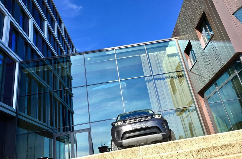 Building Exterior Built Structure Low Angle View Architecture Blue Clear Sky Day Outdoors No People Sky EyeEmNewHere Car Land Rover Discovery Structures & Lines Architecturephotography CarShow Launch The Week On EyeEm The Week On EyeEm