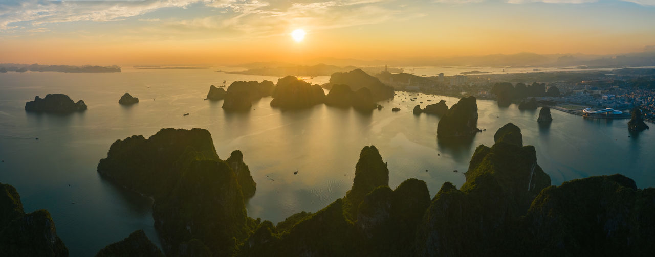 Ha Long Bay Ha Long City Sea Seascape Water Scenics - Nature Beauty In Nature Sunset Tranquility Cloud - Sky No People Rock Nature Tranquil Scene Reflection Sunlight Solid Sky