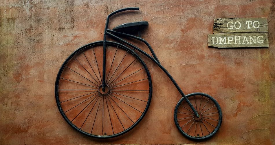 Close-up of bicycle on wall