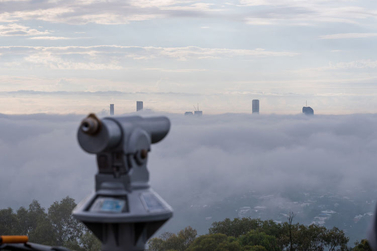 Fog in Brisbane Sky Cloud - Sky Binoculars Coin Operated Nature No People Coin-operated Binoculars Architecture Day Plant Technology Building Exterior Outdoors Surveillance Beauty In Nature Security Built Structure Tree City Travel Hand-held Telescope