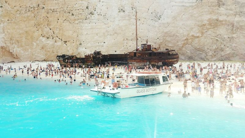 EyeEmNewHere Turquoise Water Glass Bottom Boat Shipwreck Beach Zakynthos,Greece Water Stunning Crowded Shipwreck Cove The Week On EyeEm Beautiful Place ♥ Sand Rock Wall Connected By Travel