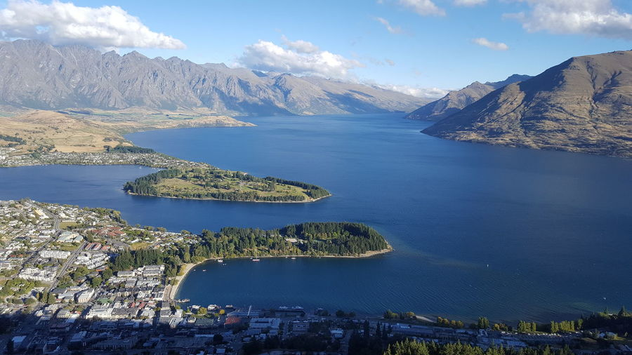 Scenic view of queenstown mountains against cloudy sky